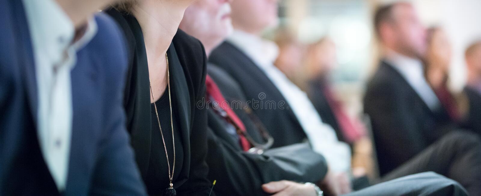 Row of business people sitting at seminar. royalty free stock photos