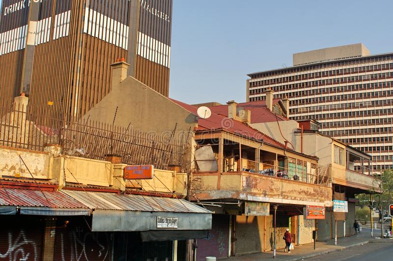 Small businesses below high rises in Johannesburg royalty free stock photo