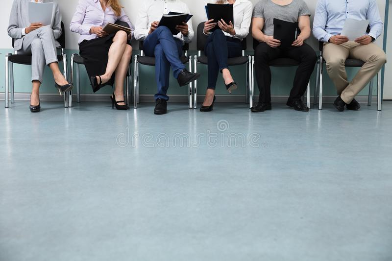 Row Of Candidates Sitting On Chair stock image