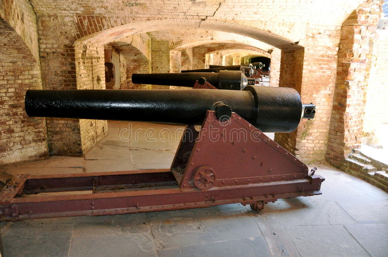 Row of Cannons in a Fort. A long row of cannons at Fort Sumter in Charleston, South Carolina royalty free stock images