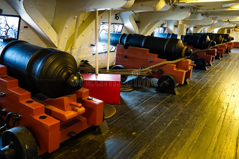 Row of cannons on the ship royalty free stock images