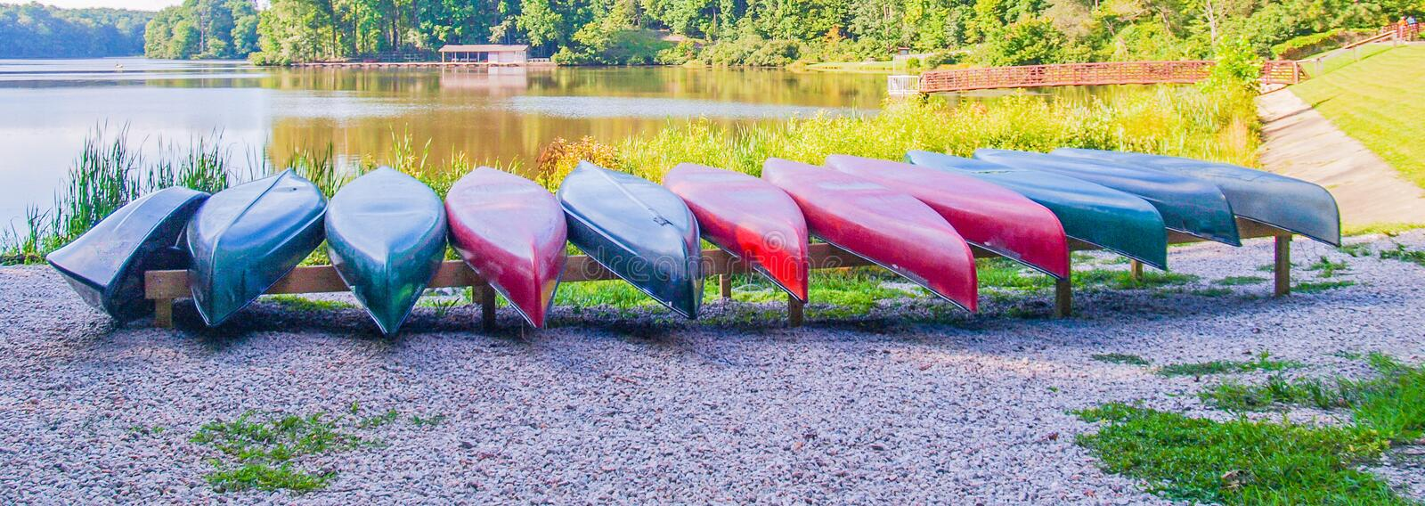 Row of Canoes at Big Lake. Canoes are put away at the end of the day and ready for the next trip on Big Lake at Umstead State Park stock photography