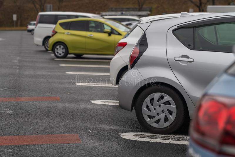 row of cars in parking stock images