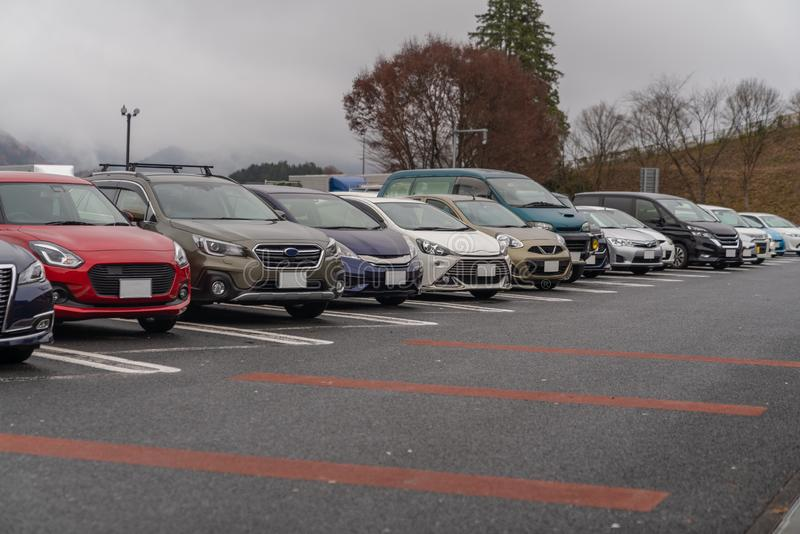 row of cars in parking royalty free stock photo