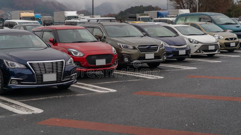 row of cars in parking stock image