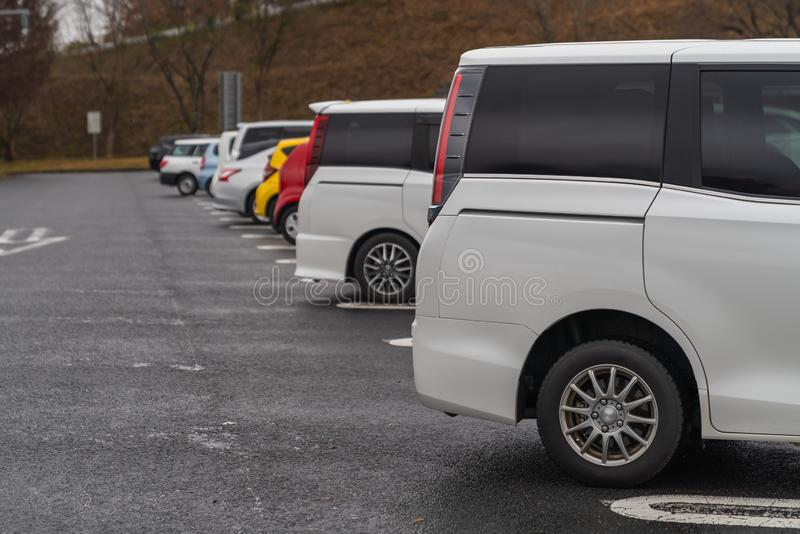 row of cars in parking stock photography