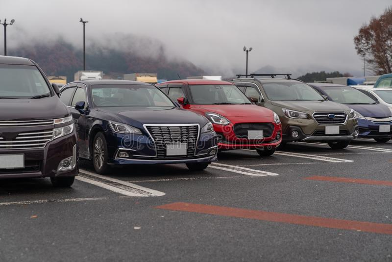 row of cars in parking stock photos