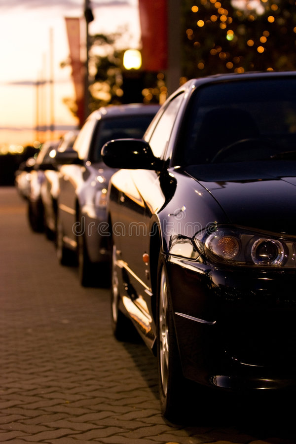 Row of cars at sunset stock photography