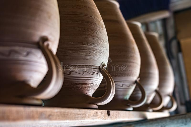 Row of ceramic jugs are on the shelf.  royalty free stock photos