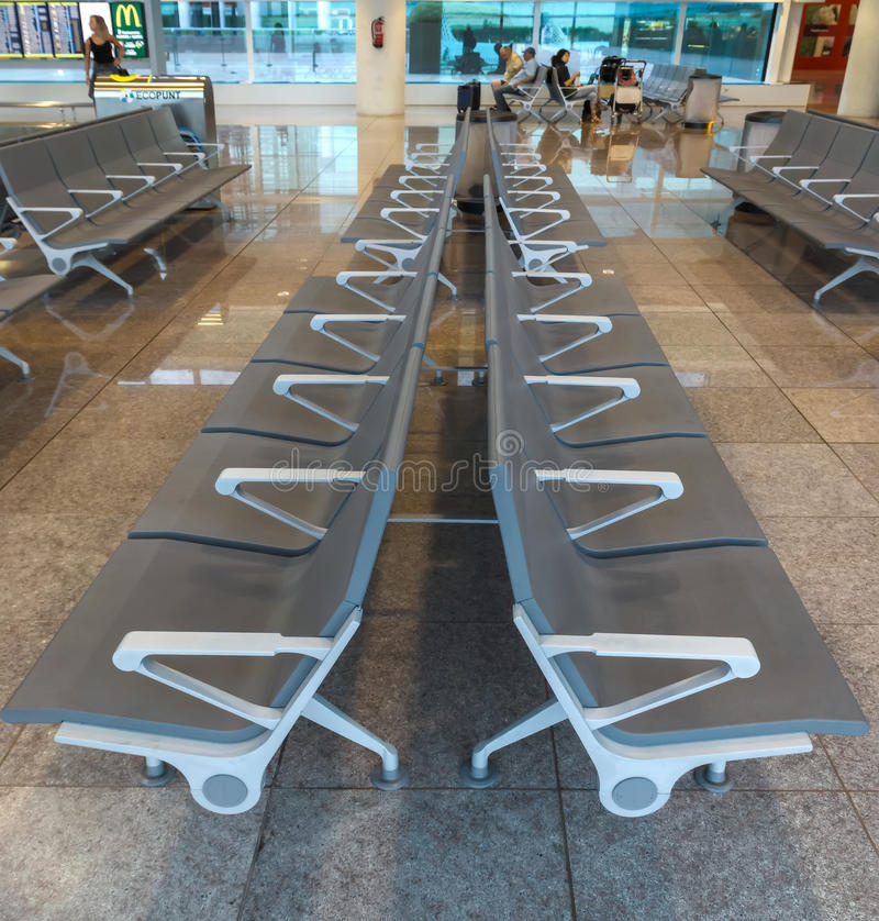 Row of chairs in Barcelona airport stock photography