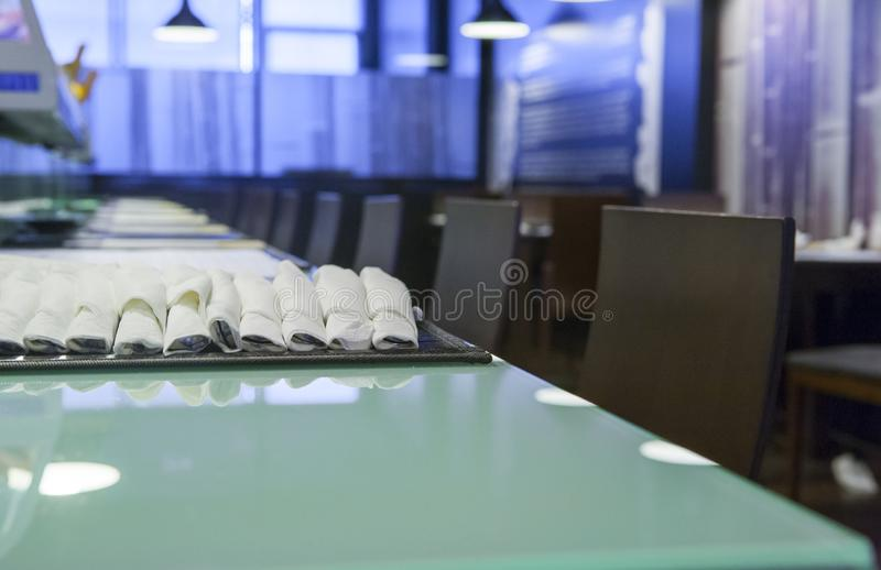 Row of chairs at empty modern japanese restaurant royalty free stock photography