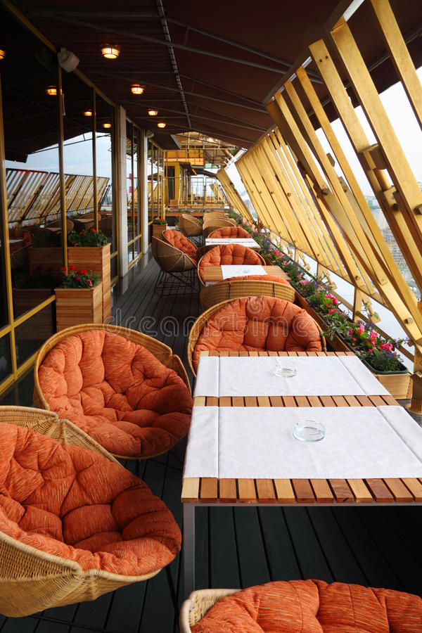 Row of chairs and tables at terrace