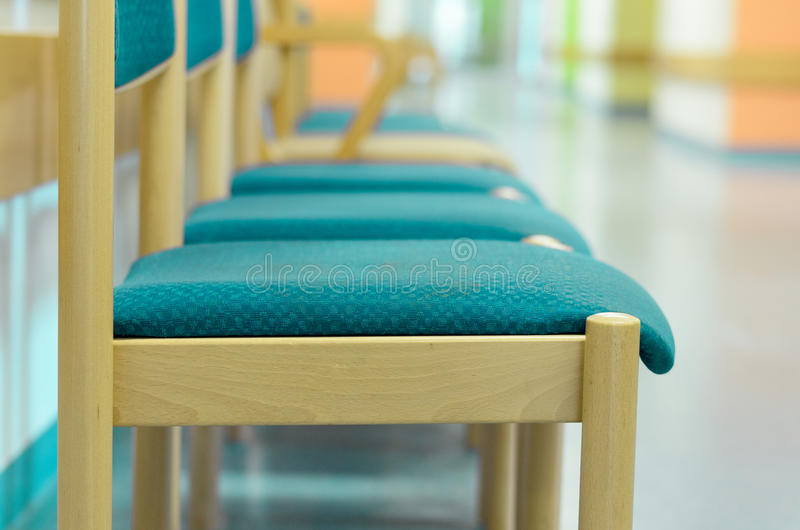 A row of chairs in a waiting room stock photography