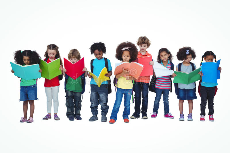 A row of children standing together reading books royalty free stock photo