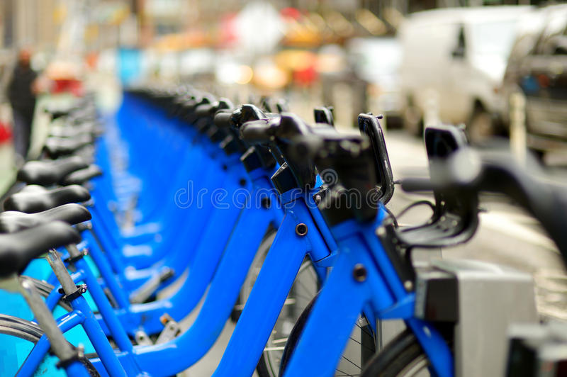 Row of city bikes for rent at docking stations in New York. USA royalty free stock image