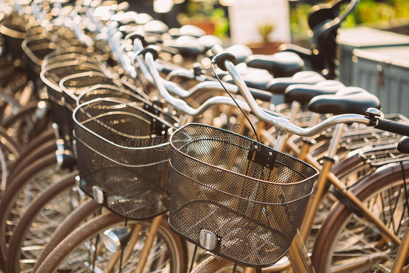 Row of city parked bicycles bikes for rent on sidewalk. Bike Bic royalty free stock photography