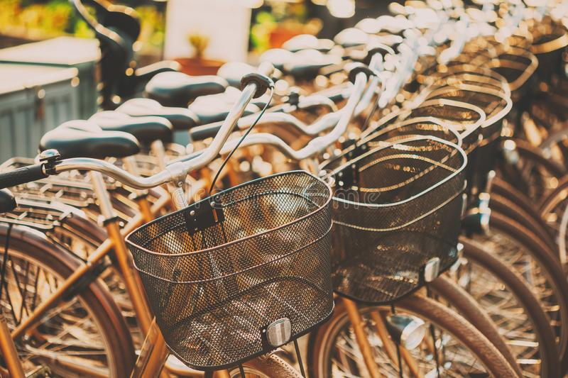 Row of city parked bicycles bikes for rent on sidewalk. Bike Bicycle Parking stock photo