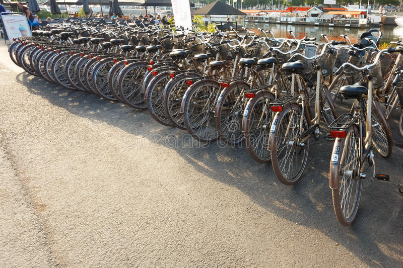 Row of city parked bicycles bikes for rent on stock image