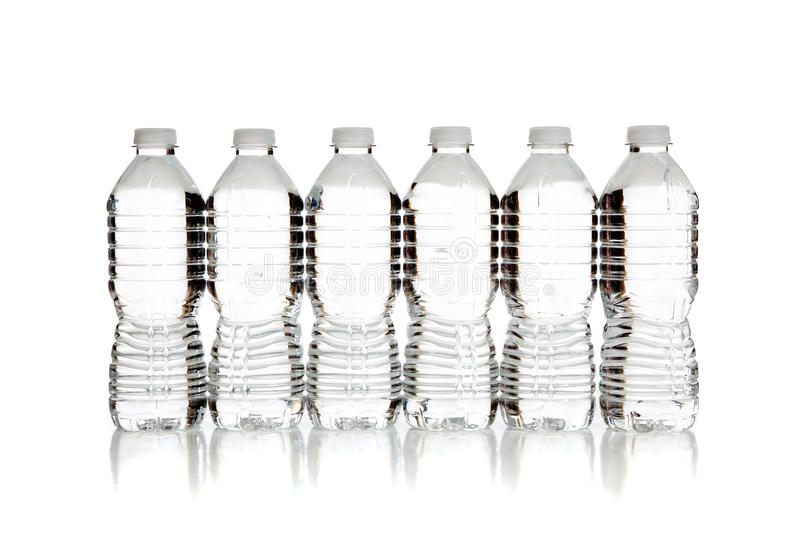 Download A Row Of Clear Water Bottles On White Stock Photo - Image: 11830864