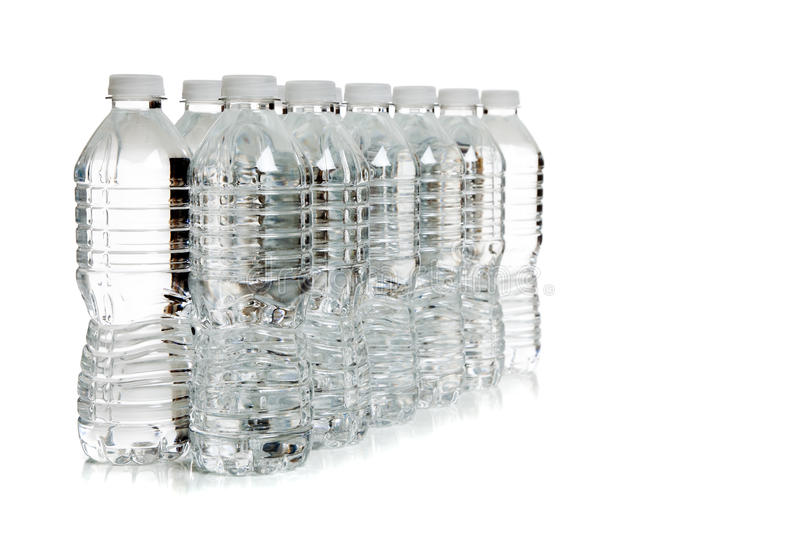 A Row Of Clear Water Bottles On White Stock Images