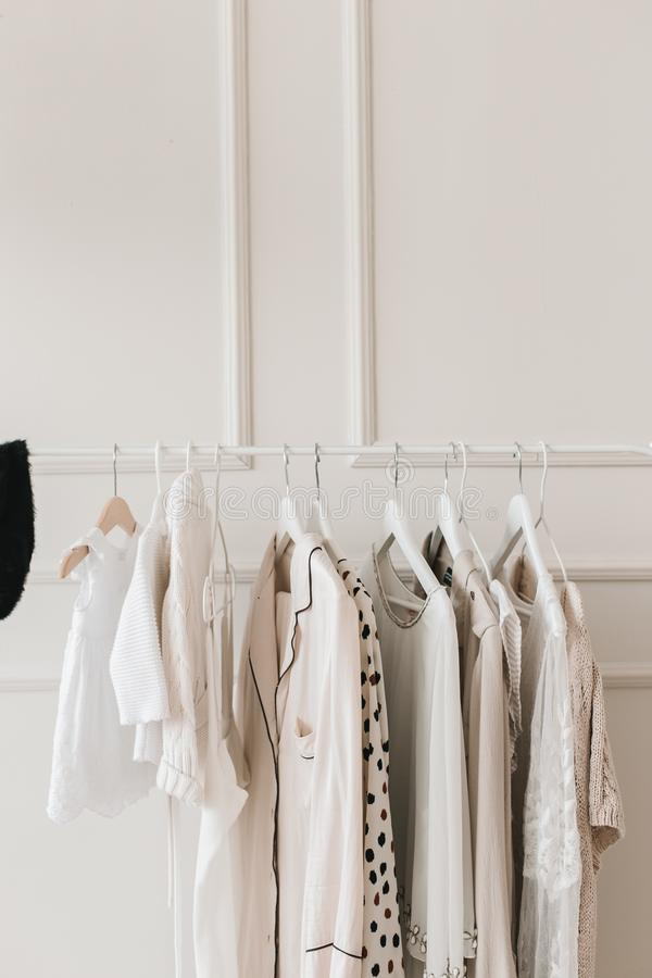 Row of cloth hanger with shirts. Minimalism stock photo