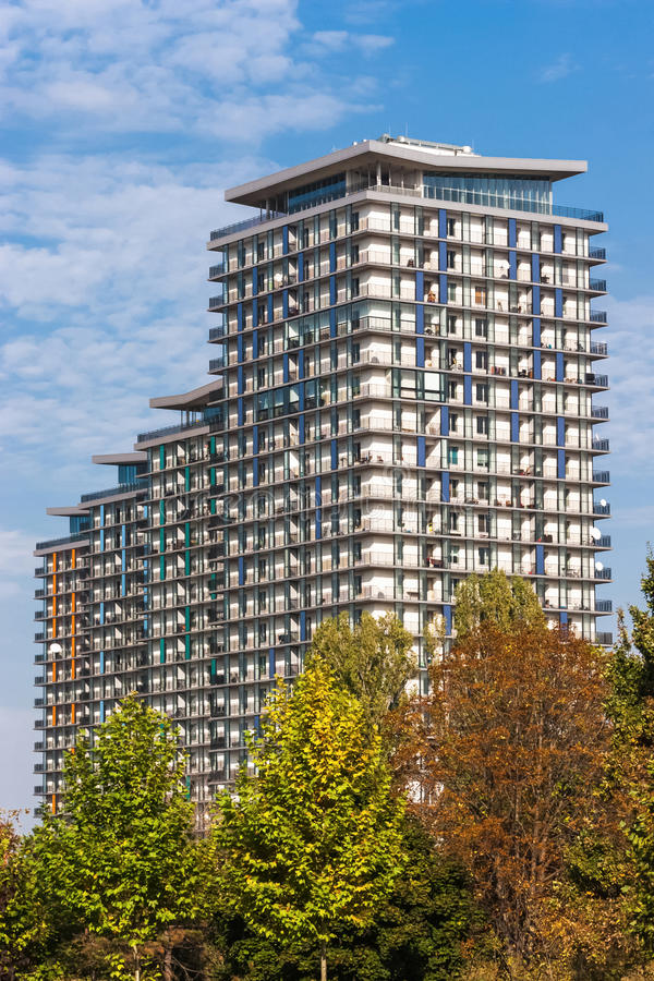 Download Row Of Colored Apartment Buildings At Noon Against Blue Sky. Stock Photo - Image: 47595514