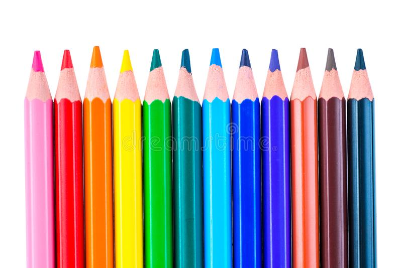 a row of colored pencils sharpened sharply on a white background stock photography