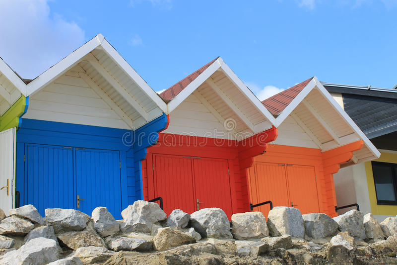Colorful beach chalets stock photos
