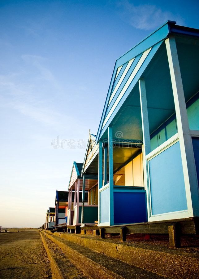 Row of colorful beach huts. On Southwold beach at sunrise, Suffolk, East Anglia, England royalty free stock photography