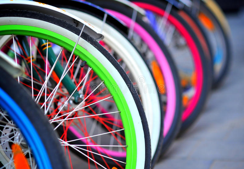 Bike tires detail. A row of colorful bike tires parked royalty free stock photography
