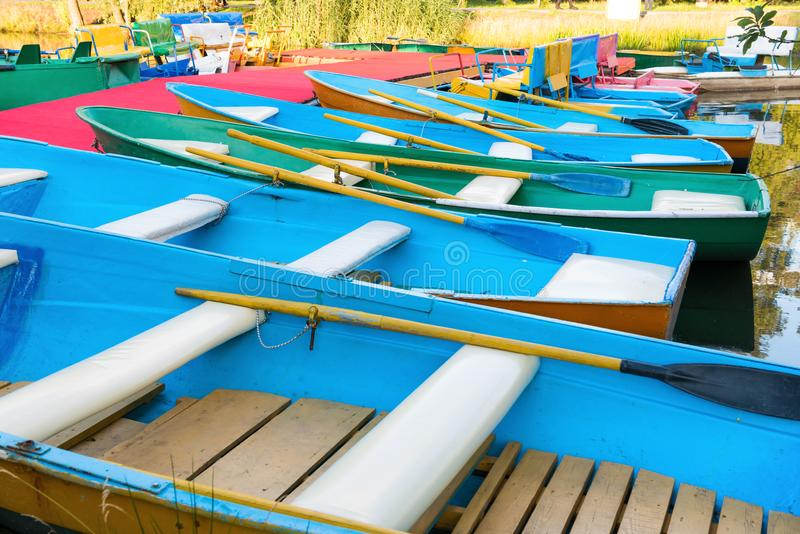 Row of colorful boats at pier. Row of many empty colorful boats at pier royalty free stock photo