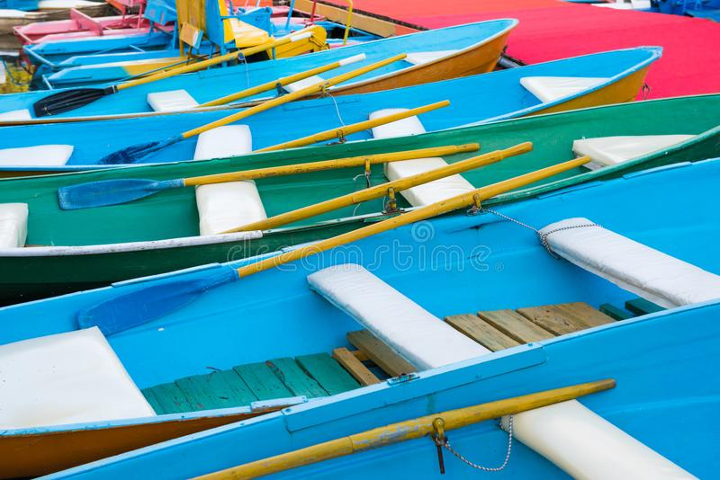 Row of colorful boats at pier. Row of many empty colorful boats at pier stock image
