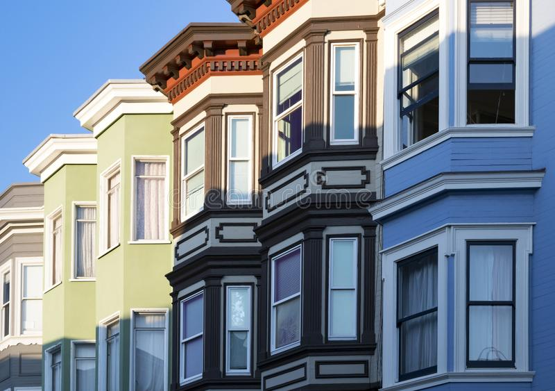 Row of colorful buildings with bay windows architecture in San F. Row of colorful buildings with classic bay windows architecture in San Francisco, California royalty free stock photo