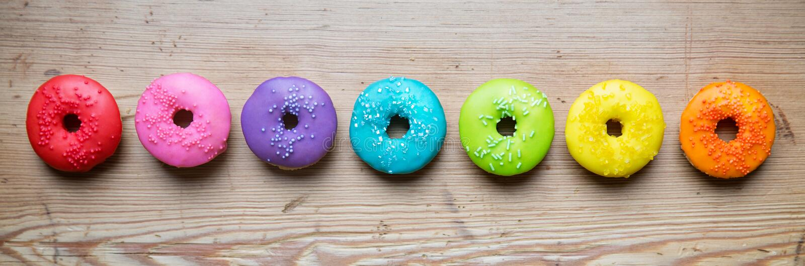 Row of colorful donuts. Colorful donuts in a row