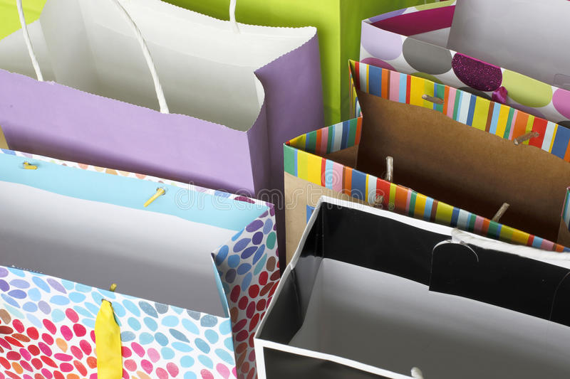Row of colorful gift bags stock images