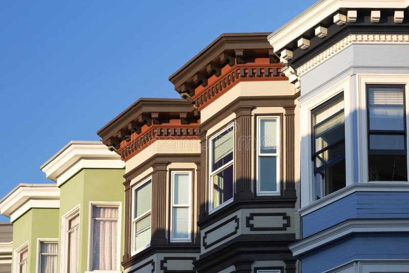 Row of colorful historic buildings with bay windows in San Franc. Isco, California stock photos