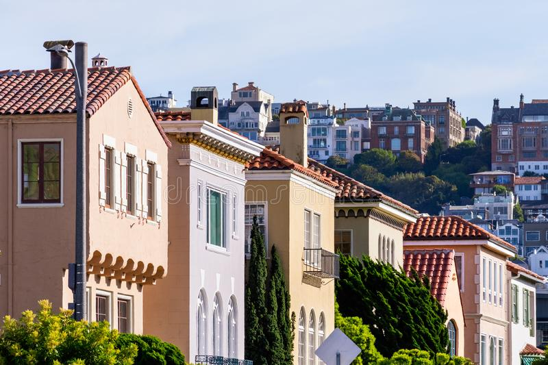 Row of colorful houses in the Marina District residential neighborhood; Pacific Heights residential district visible in the. Background; San Francisco royalty free stock images