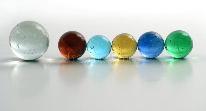 Row of Colorful Marbles royalty free stock photography