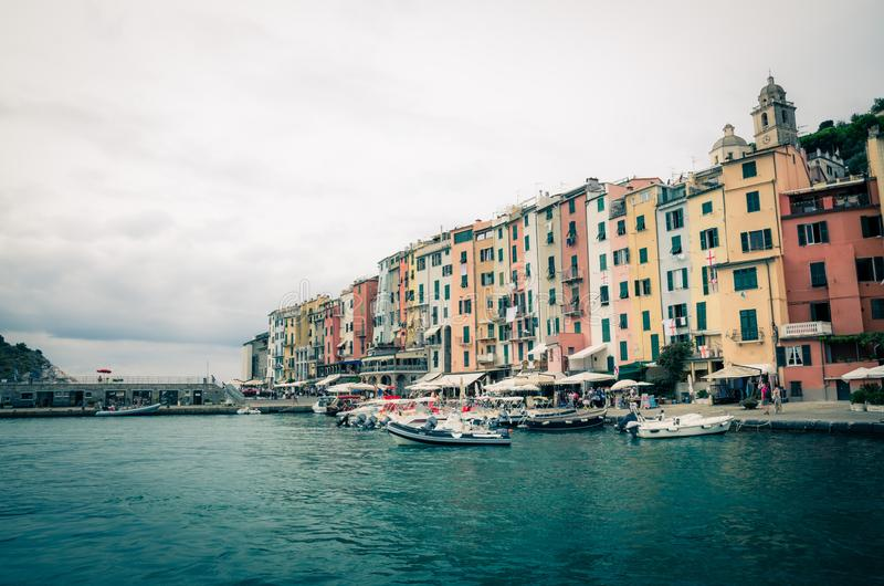 Row of colorful multicolored buildings houses of Portovenere coastal town village and boats in harbor of Ligurian sea, Riviera di stock photography