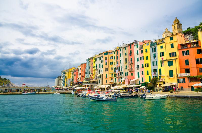 Row of colorful multicolored buildings houses of Portovenere coastal town village and boats in harbor of Ligurian sea, Riviera di. Levante, National park Cinque royalty free stock image