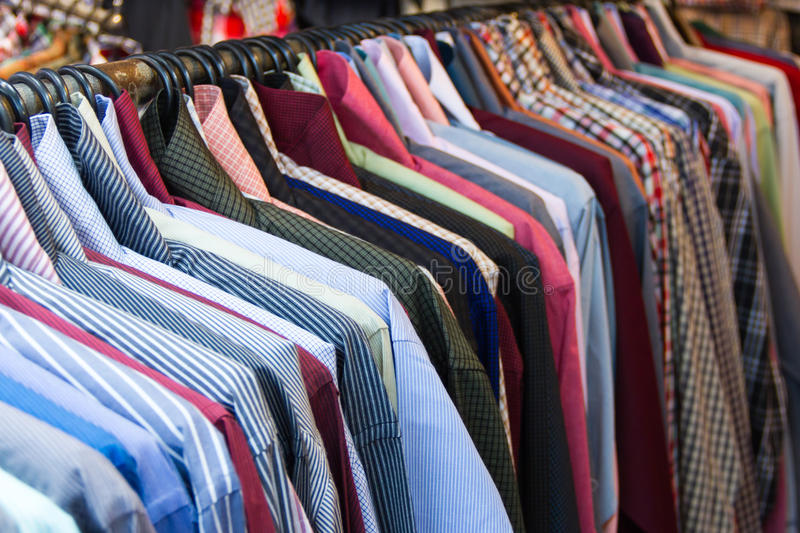 Row of colorful row shirts stock photos