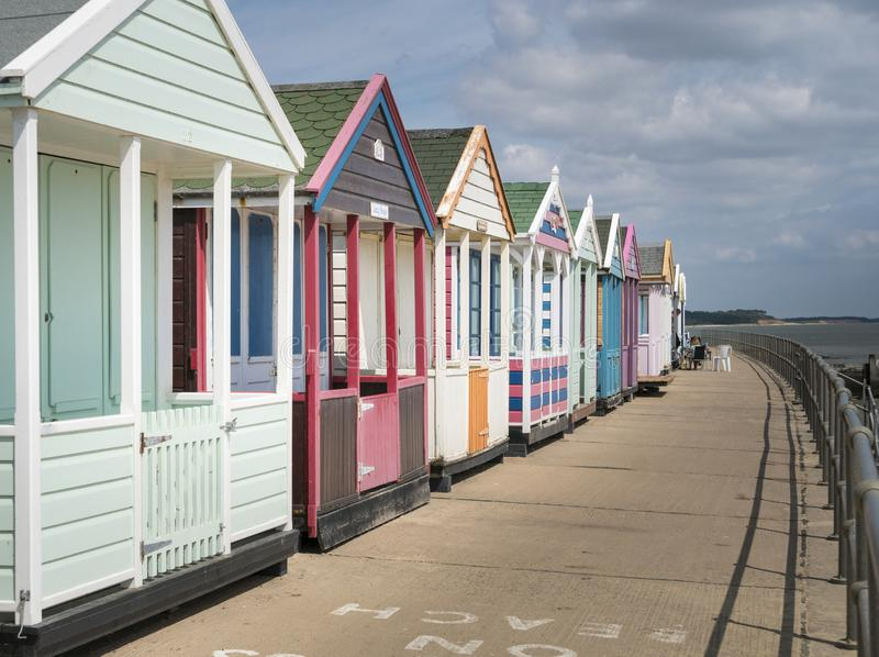 A Row of Colourful Beach Huts stock images