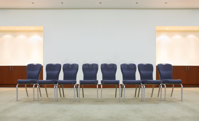 Row of comfortable chairs in waiting room royalty free stock images