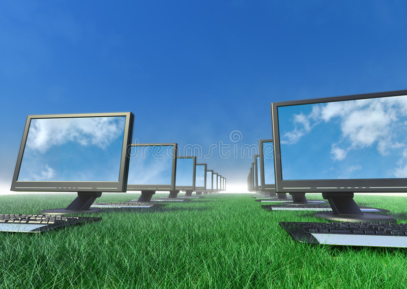 Row of computers in a field of grass. A row of computers in a field of grass royalty free stock images