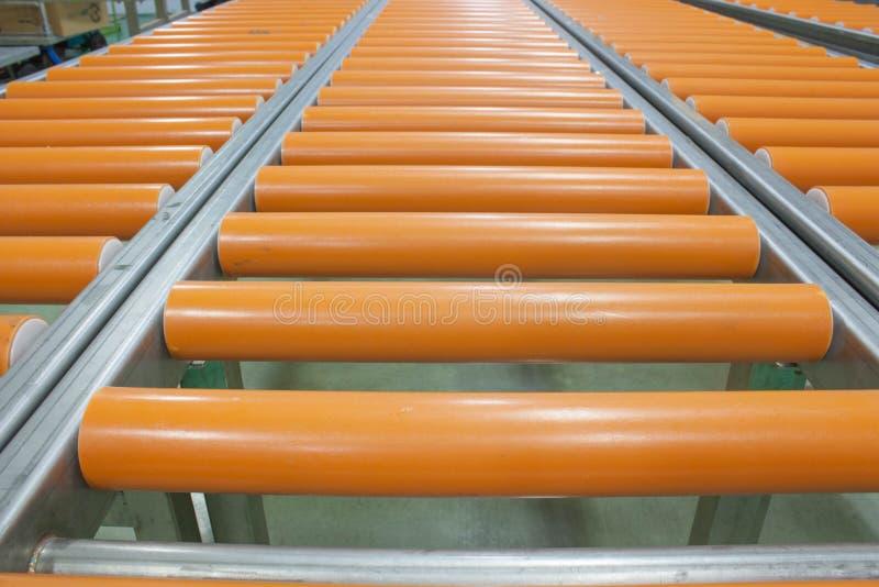 Row conveyer stock image