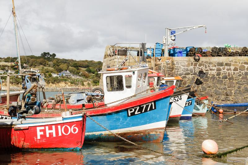 Row of Cornish fishing boats. Row of colourful Cornish fishing boats at Coverack, The Lizard, Cornwall, UK royalty free stock photo
