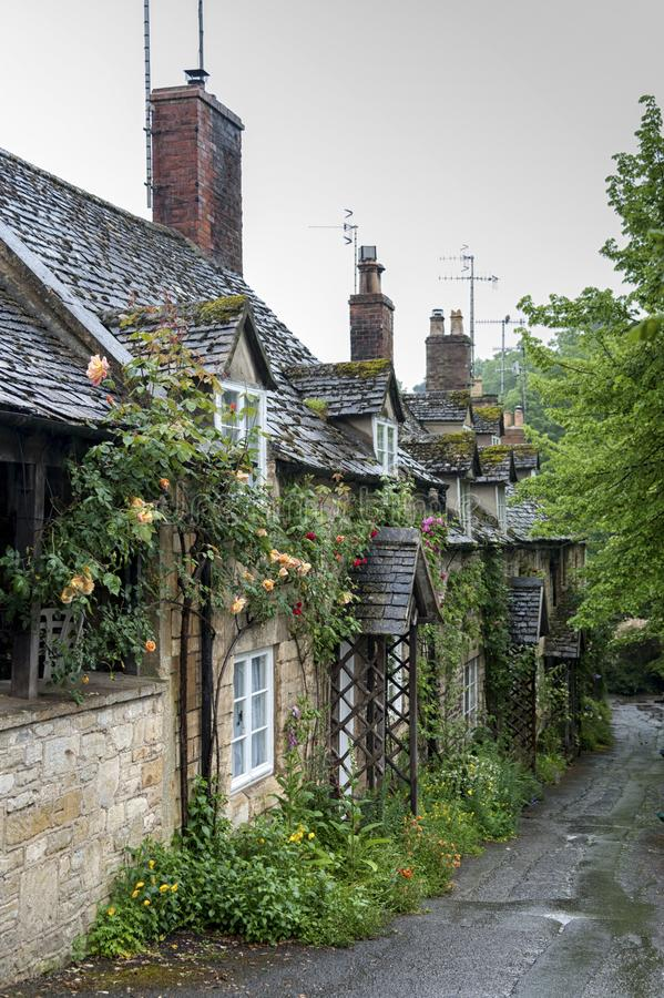 Row of cottages in the ancient Anglo Saxon town of Winchcombe, Cotswolds, Gloucestershire, England. WINCHCOMBE, ENGLAND -MAY, 25 2018: Row of cottages in the royalty free stock image