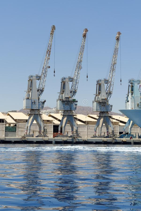 Download Row Of Cranes And Their Reflections In The Sea In Eilat Harbor Stock Photo - Image: 31471320