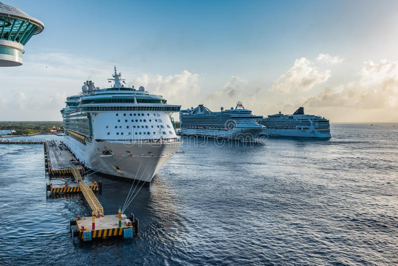 Row of Cruise Ships in the Caribbean. Tied to the docks at sunset stock photos