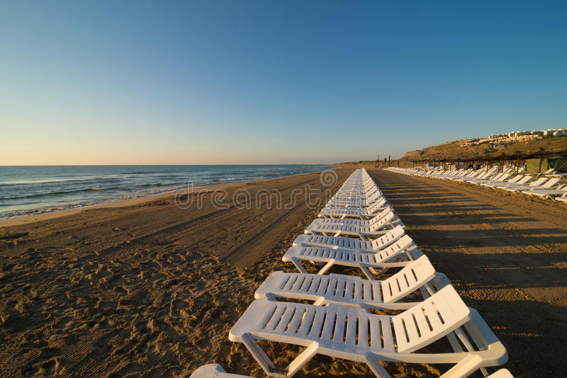Row of deckchairs royalty free stock images